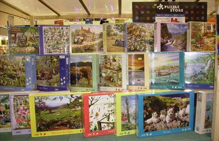 Selection of jigsaws at our shop in Chester Market